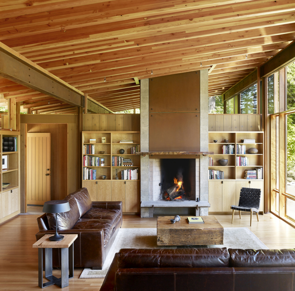The living area has a wood-burning fireplace and is part of an open plan volume