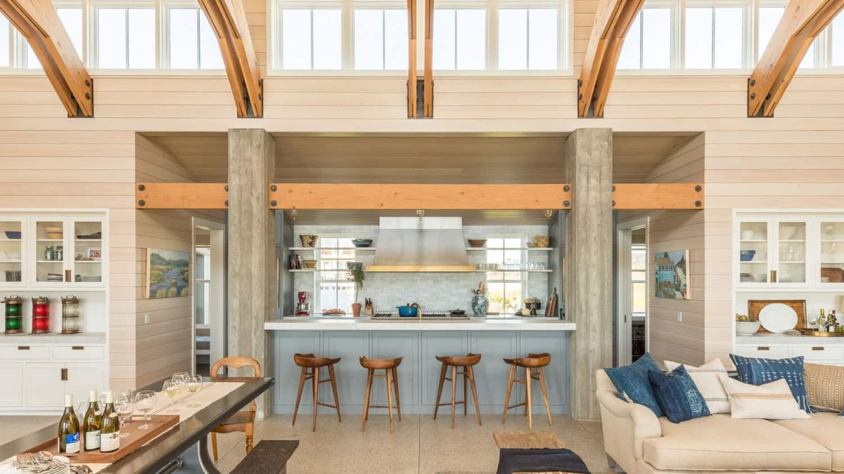 The kitchen is part of the central living room, being positioned between the seating areas