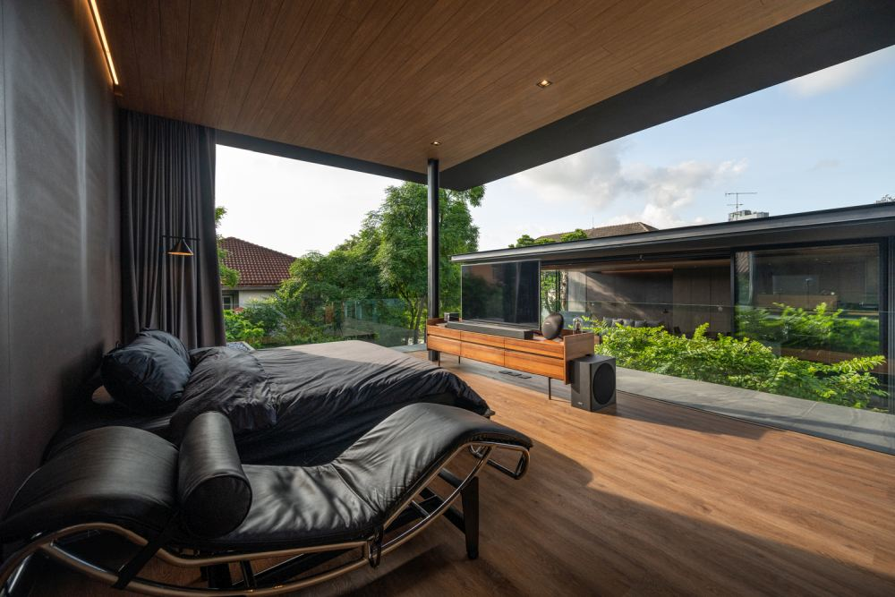 The master bedroom has a direct view towards the living areas and to the pool area below