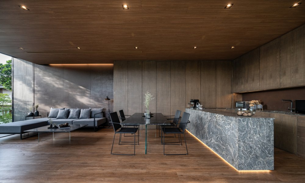 The living room, kitchen and dining area are combined into a large and welcoming space with a lovely view