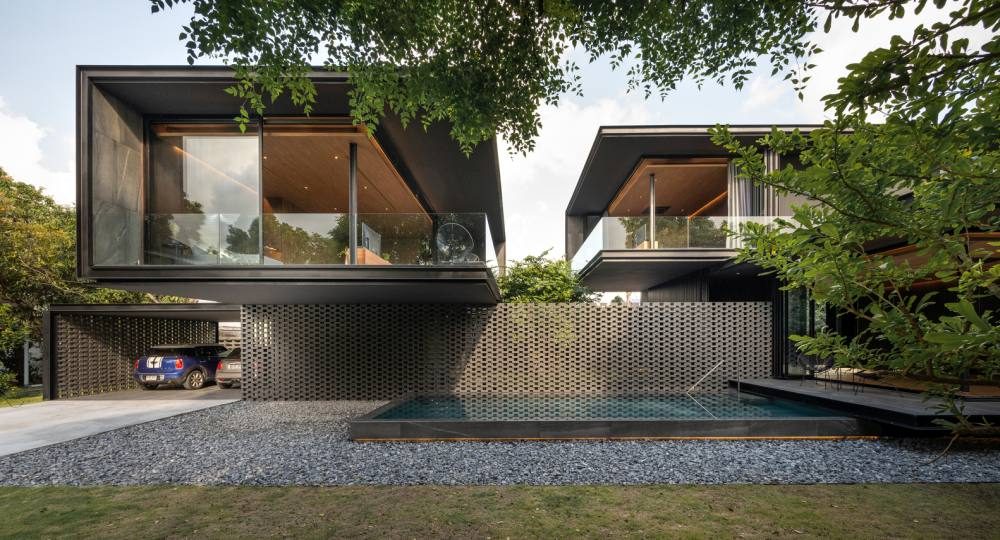 The living area is partially cantilevered over the parking area and the swimming pool