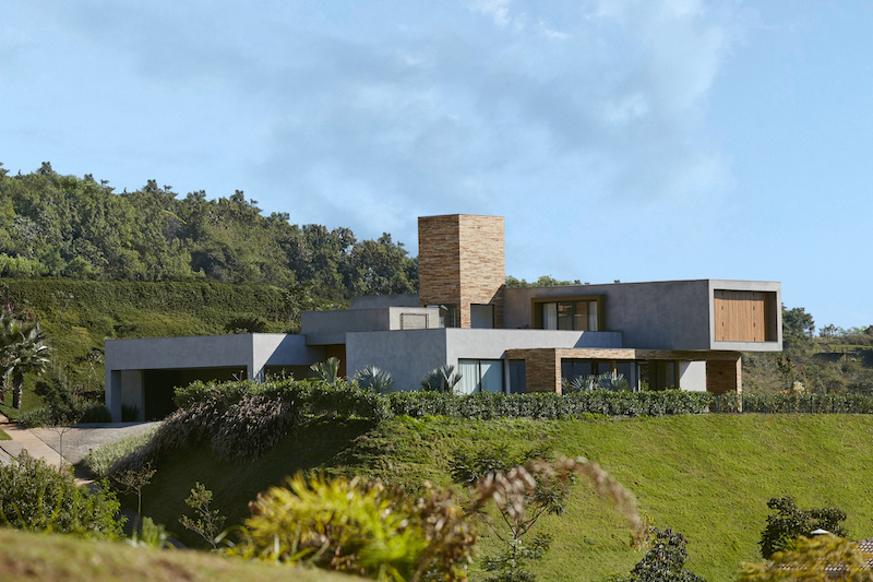 The house is generous in size and is structured into several volumes with different forms and sizes