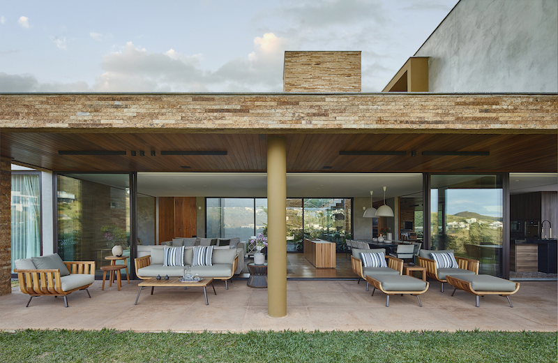 The ground floor social areas open up to covered outdoor spaces that serve as seamless extensions