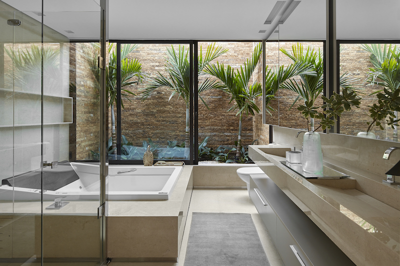 The master bathroom even has its own mini garden which brings in a fresh vibe as well as natural light