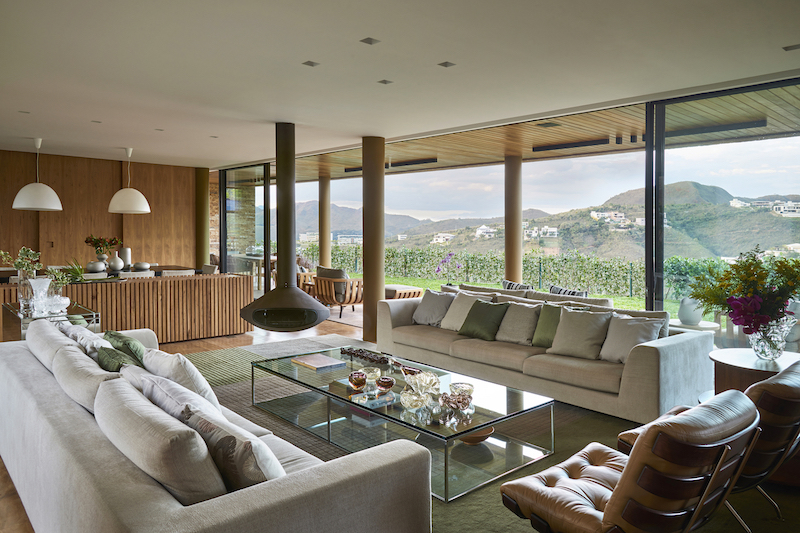 Large windows and sliding glass doors expose the living spaces to the expansive views