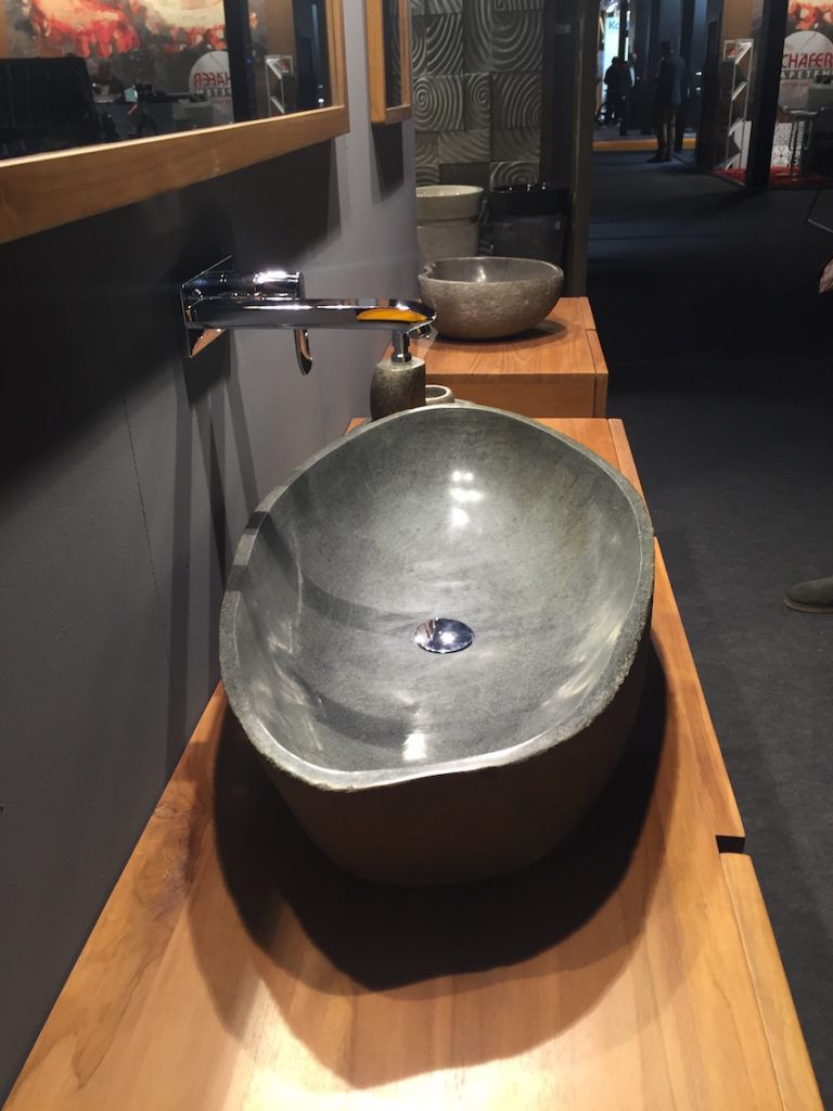 Vessel-shaped stone sinks give a particularly natural feel.