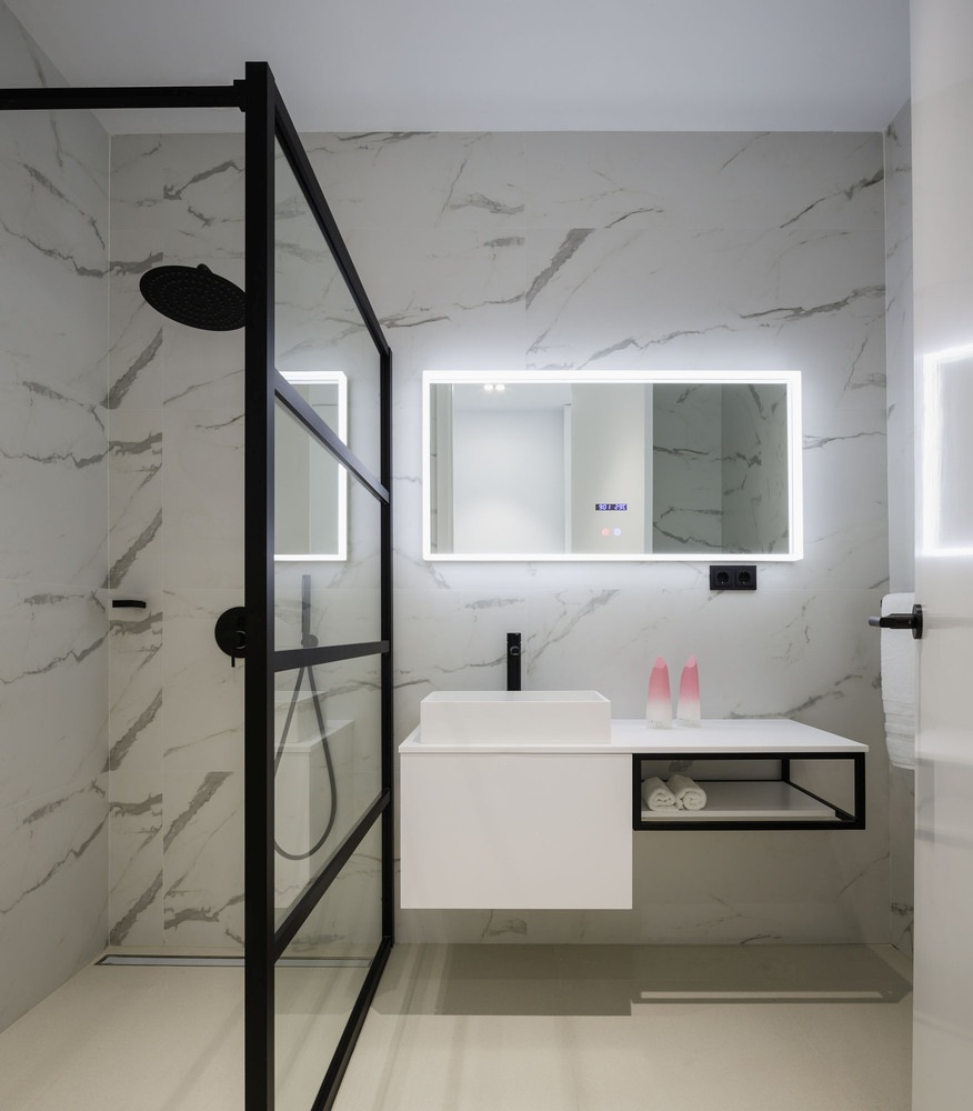Each bedroom has its own en-suite bathroom with stylish marble tiled walls and a walk-in shower