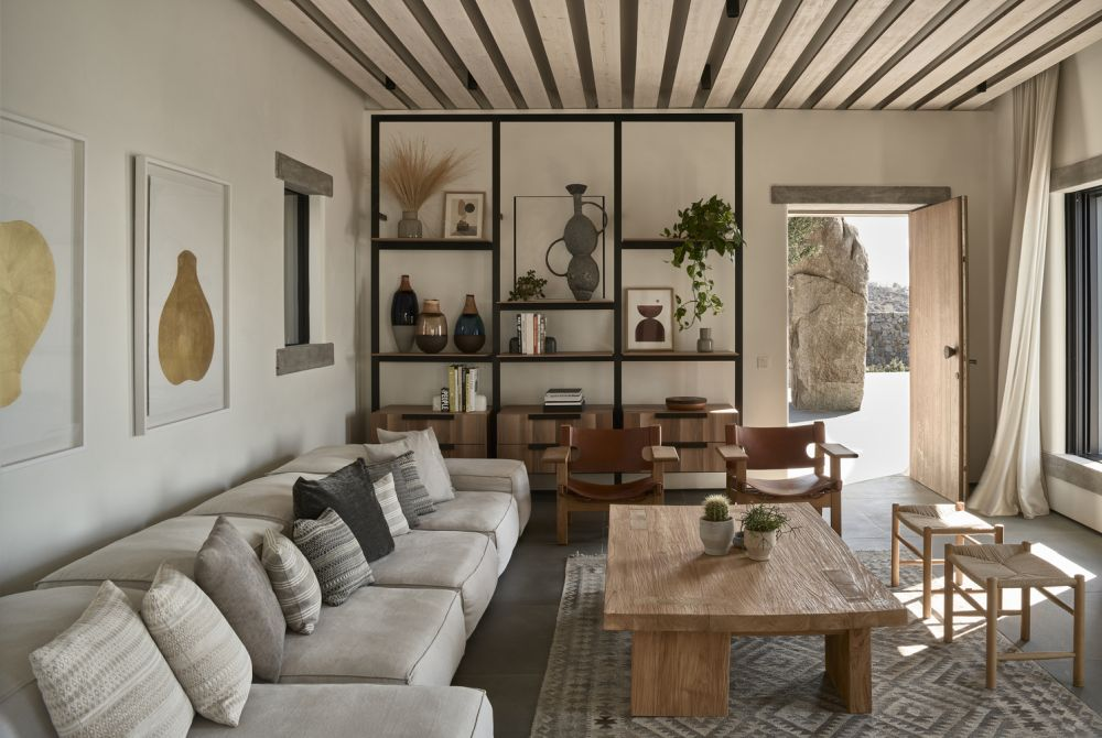 The main entrance leads directly into the living room and is marked by a simple wooden door