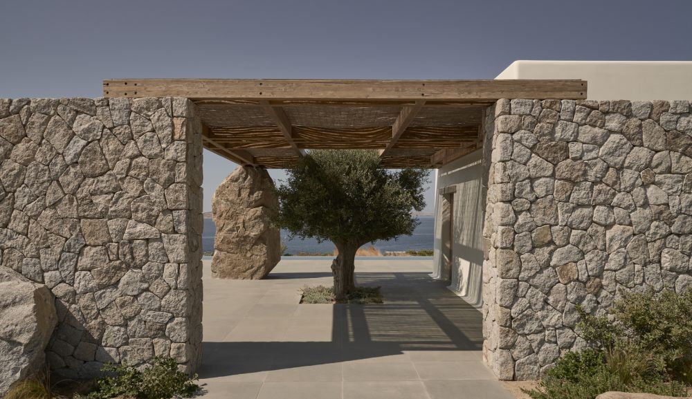 The stone walls have a beautiful natural texture and help the house to easily blend in with the local vernacular