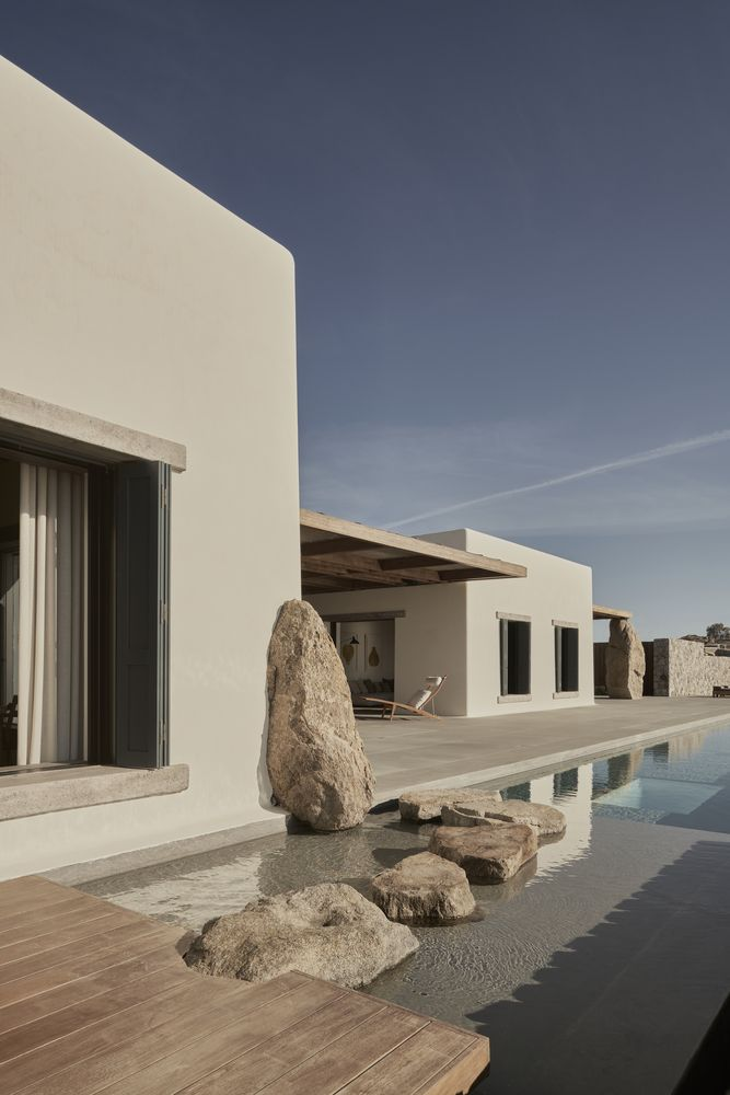 The stones form a bridge across the water, adding character to the poolside deck
