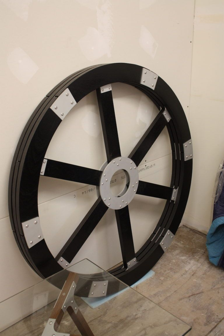 This wagon-wheel wall piece features another style of aluminum joinery.