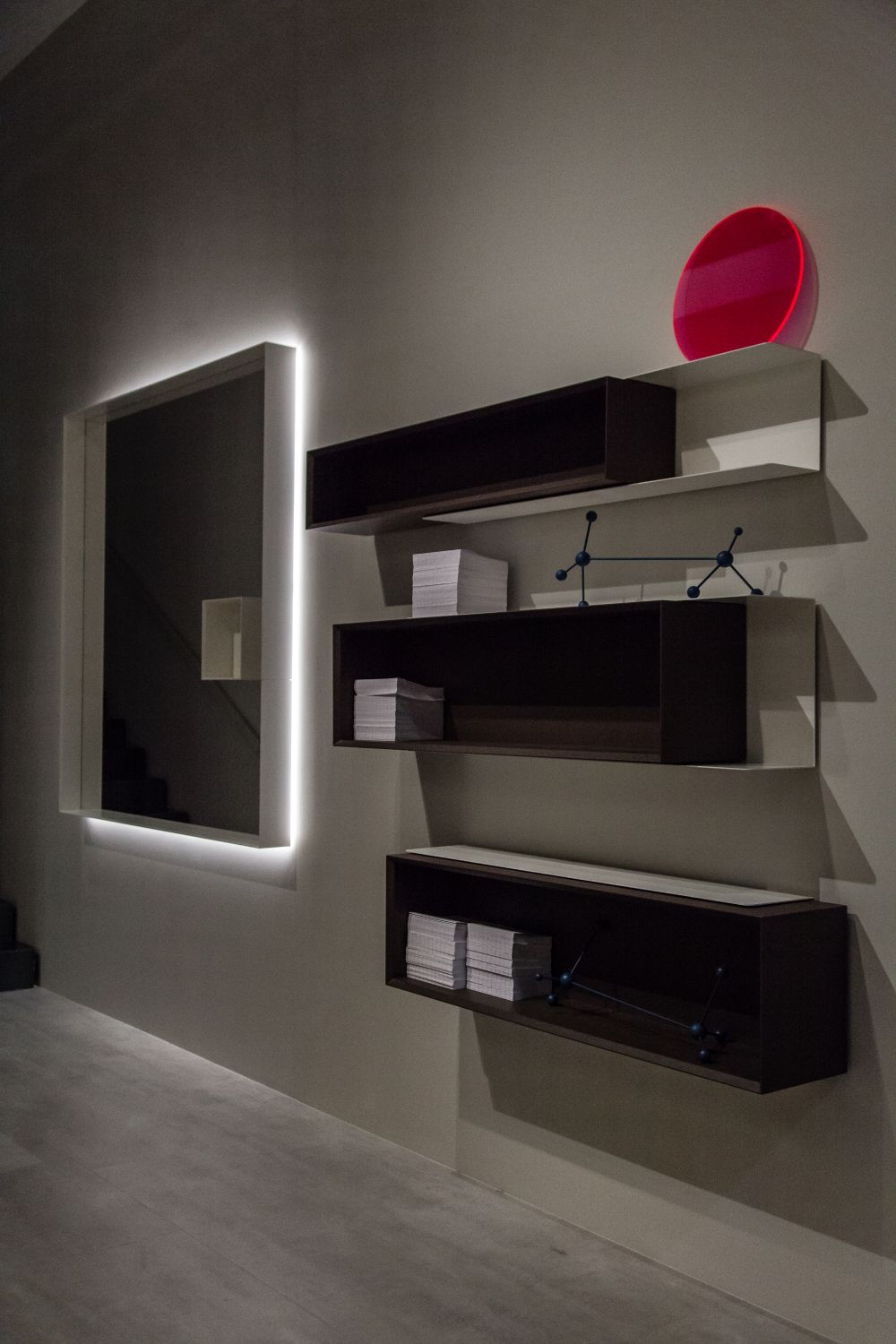 Box-style shelves like these ones are great because they look neat and they provide two surfaces on which to put things
