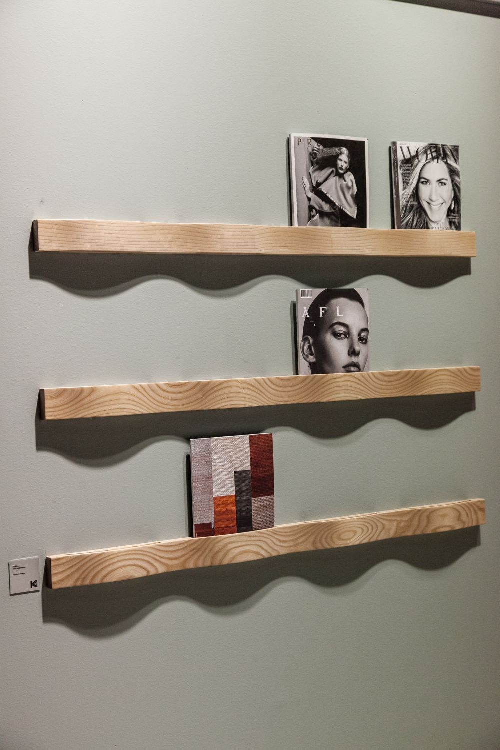 These shallow and minimalist wall shelves are designed to keep magazines. An interesting alternative to a rack