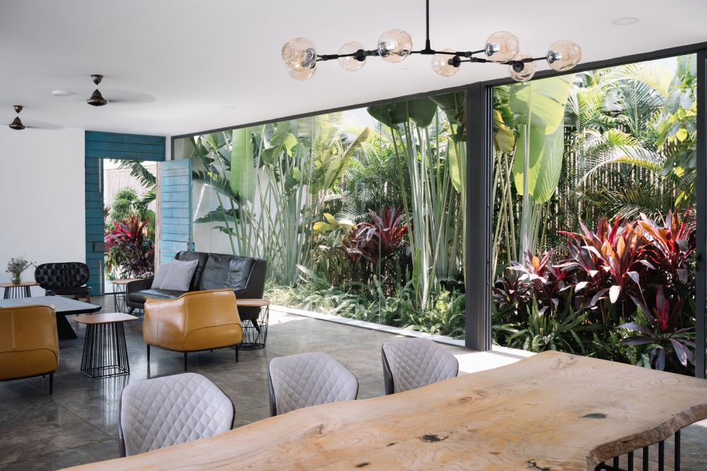 The living room and dining area have an amazing courtyard filled with lots of lush greenery