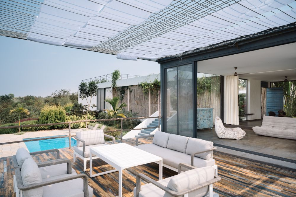 The living area and the terrace communicate seamlessly through the sliding glass doors