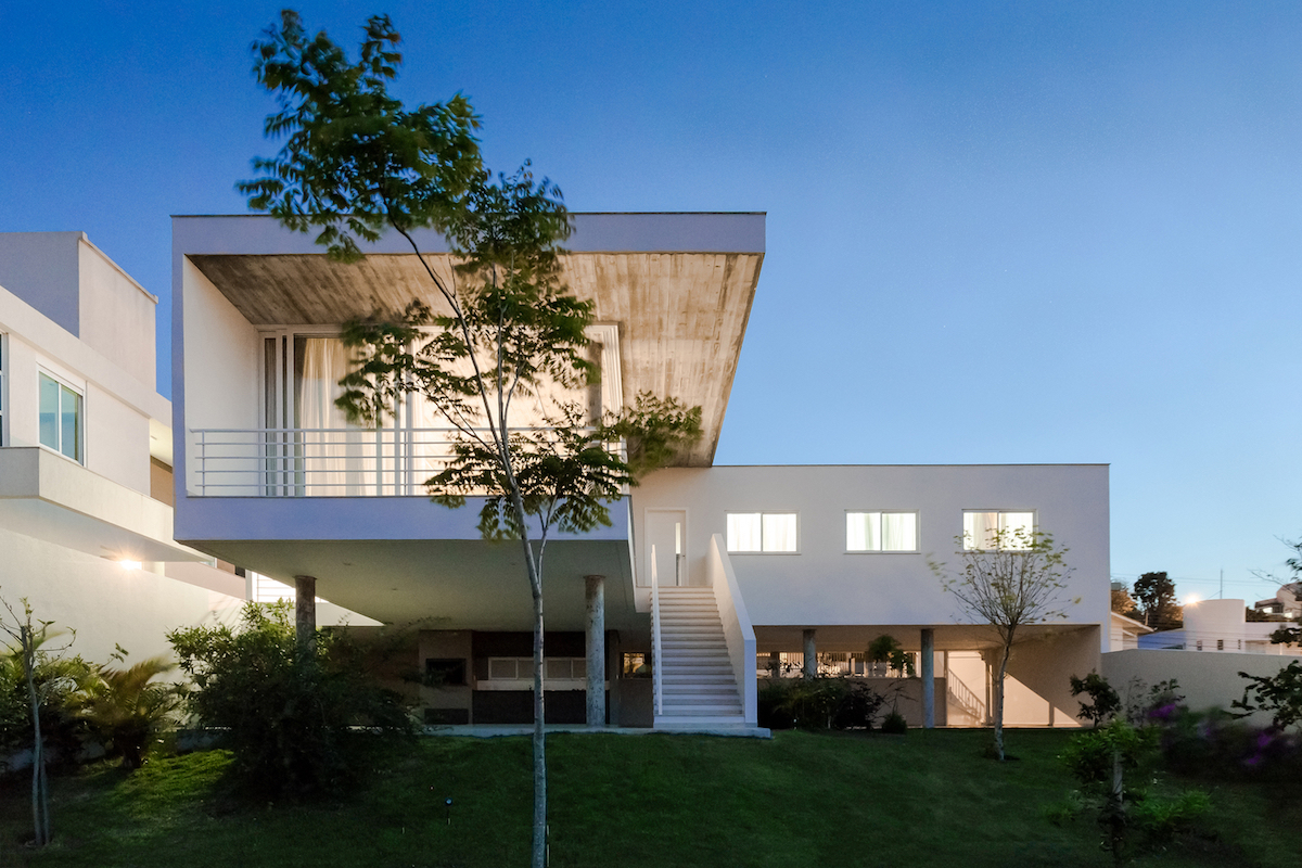 The upper floor cantilevers to form a covered entertainment area with direct access to the yard