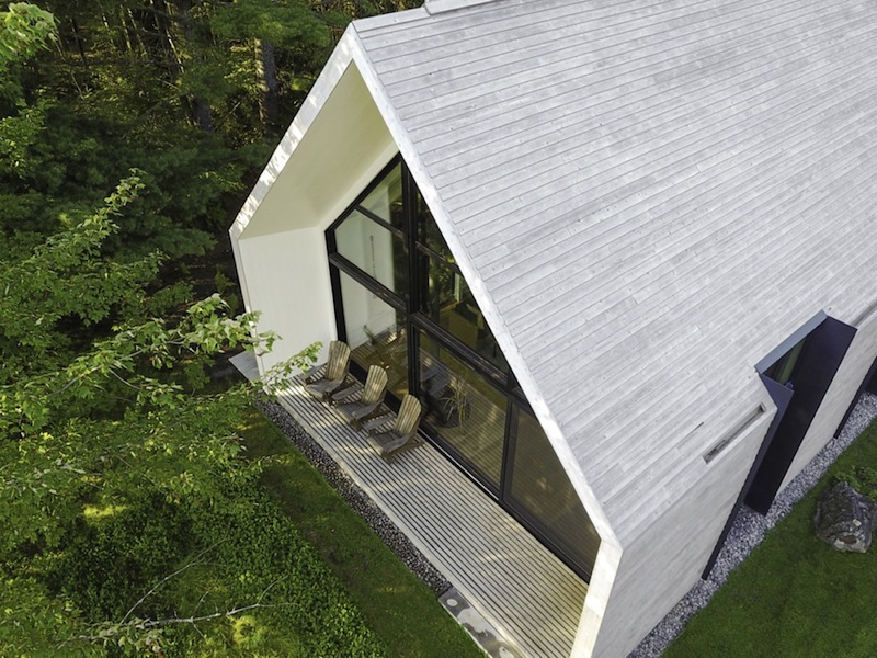 The large gable roof extends outside to also cover a small porch just outside the living room