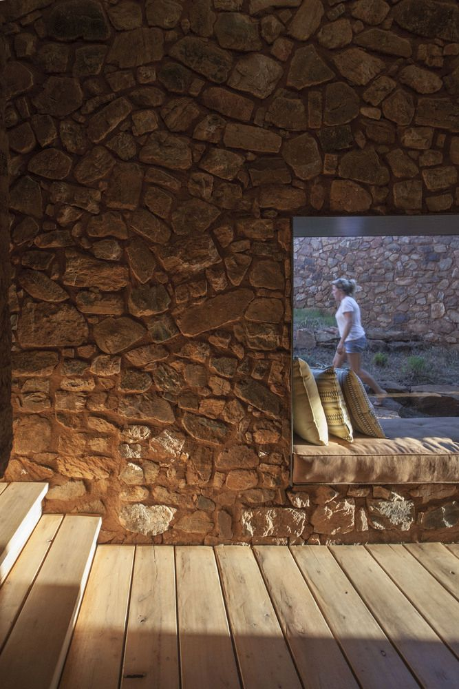 The thick walls help to regulate the temperature inside the house throughout the entire year