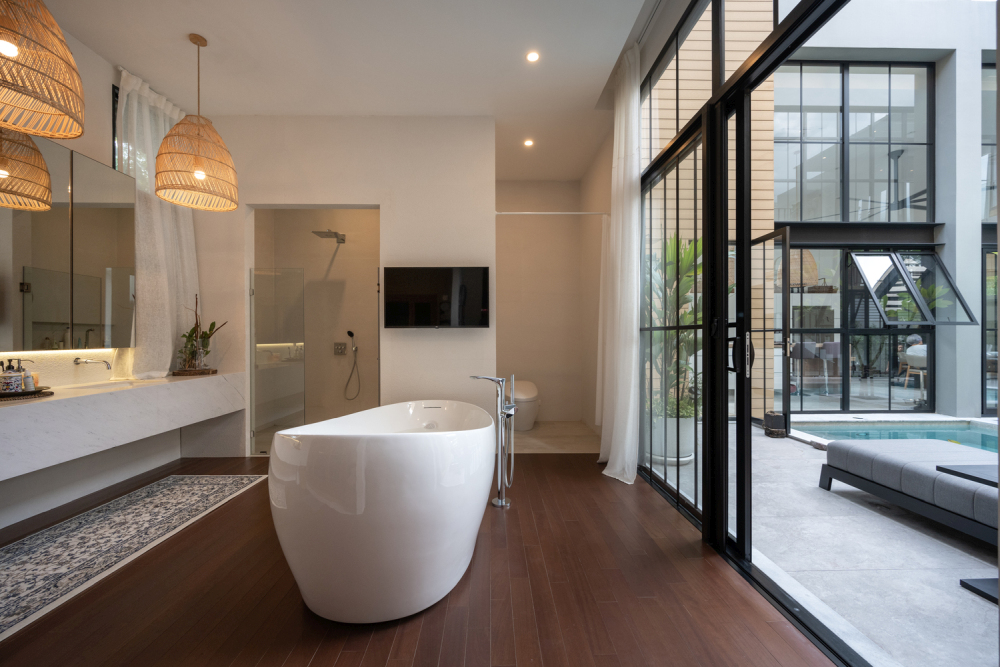 The central pool area is linked to all sides of the house, including this elegant bathroom