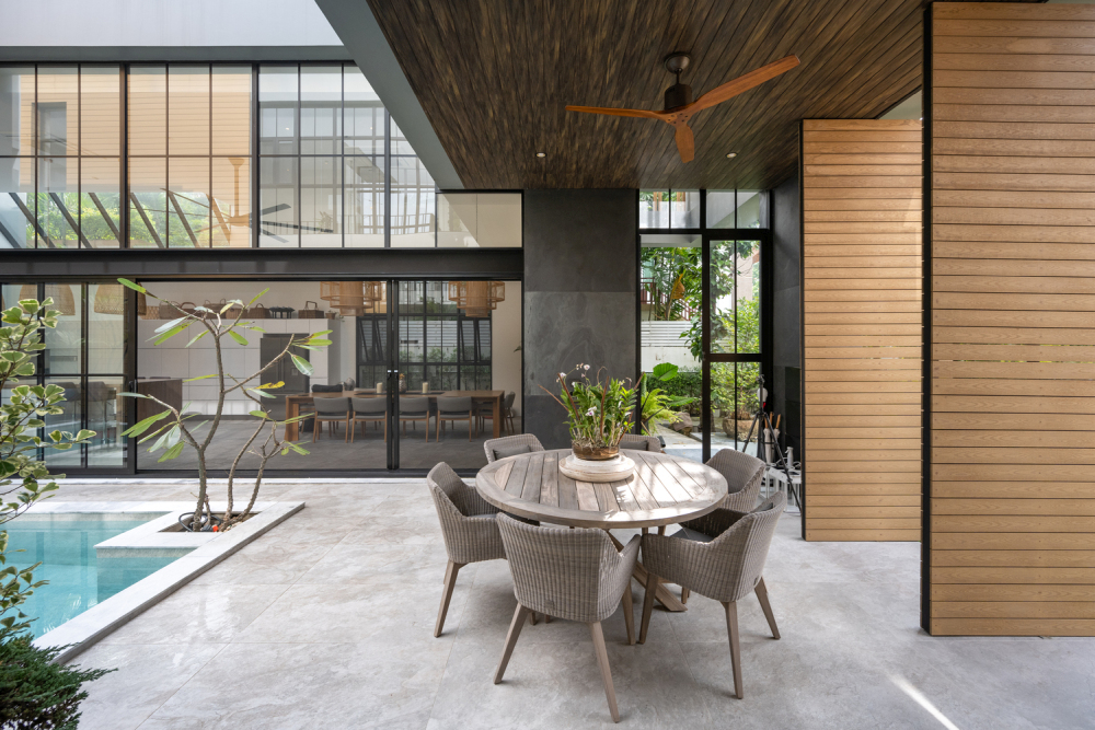 The poolside terrace features a sheltered area for lounging and socializing
