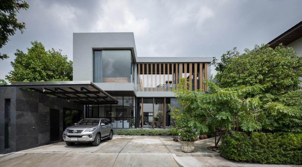 The house has a modern and simple overall aesthetic both inside and out
