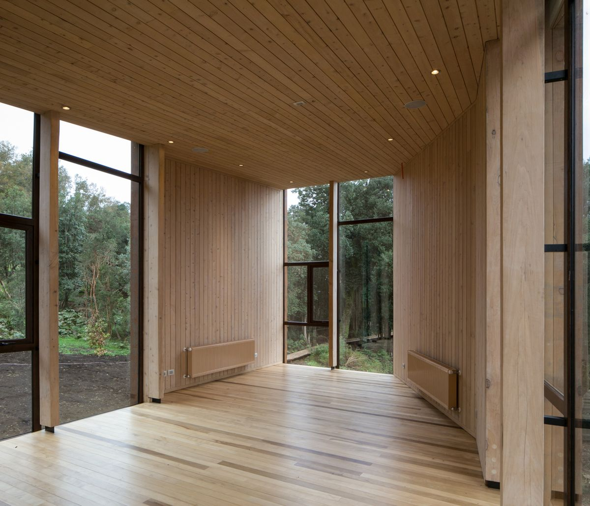 Warm wood covers the floor, ceiling and walls creating a very soothing and welcoming ambiance