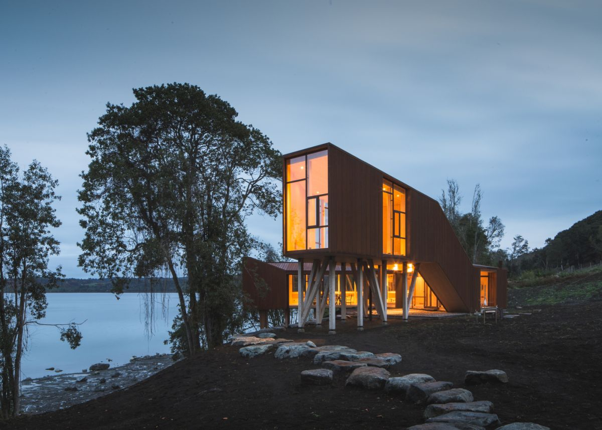 One section of the house is elevated on stilts which gives it a better view over the lake and the surroundings