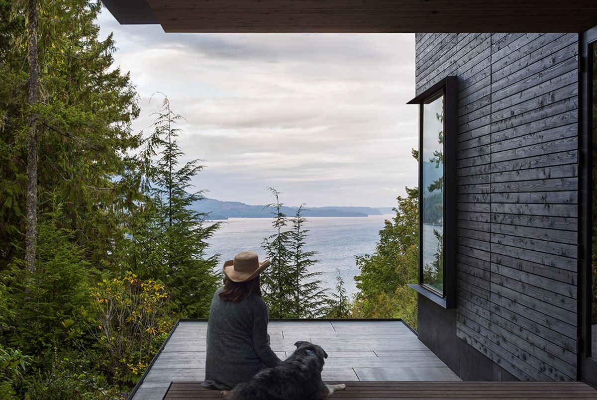 a small porch marks the entrance and provides a gorgeous view of the surroundings