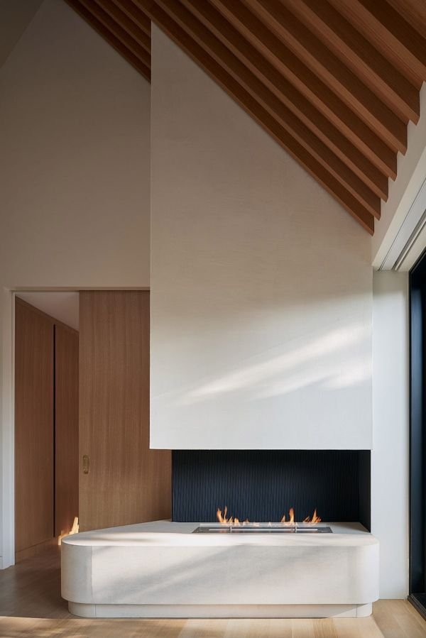 A minimalist fireplace adds a ton of beauty and character to the top floor lounge room