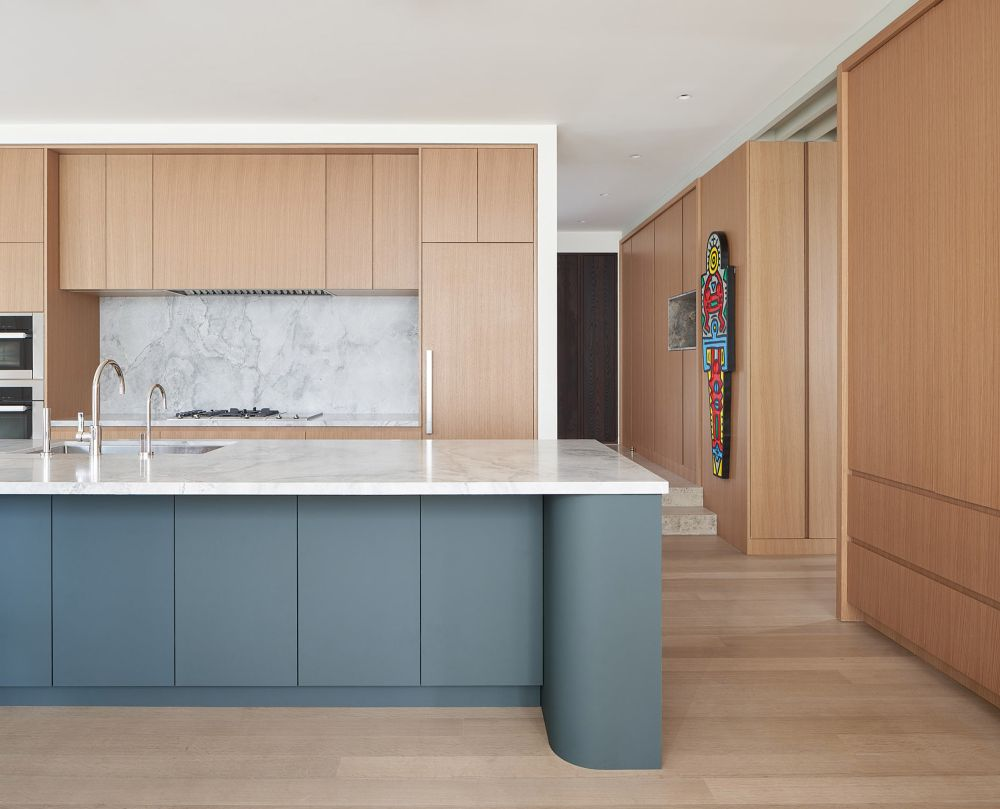 The custom oak cabinetry and furniture give the house a warm feel without darkening the color palette
