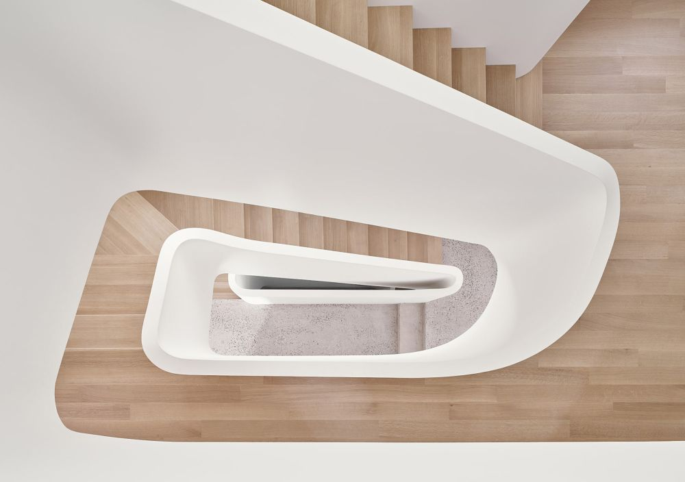 The three floors are connected by a beautiful new staircase made of bended plywood
