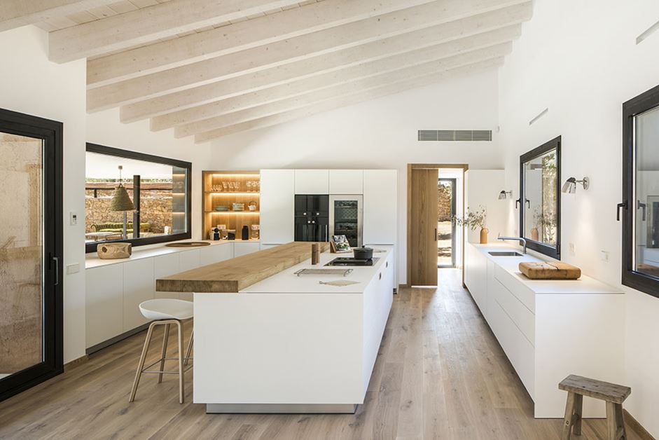 Plenty of wood keeps the modern kitchen from feeling too cold.