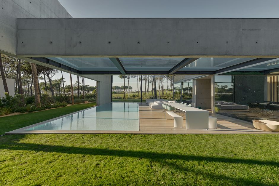 Surrounded by green grass and plantings the concrete areas do not seem at all sterile.