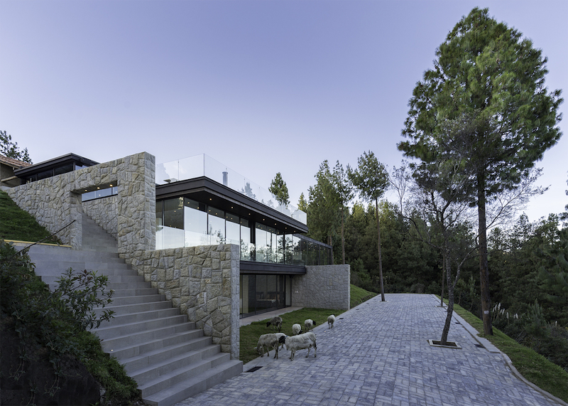 The existing house is an adobe structure which has to remain the focal point of attention on the site