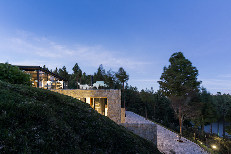The rooftop of the new structure doubles as a terrace and an extension of the old house's living area