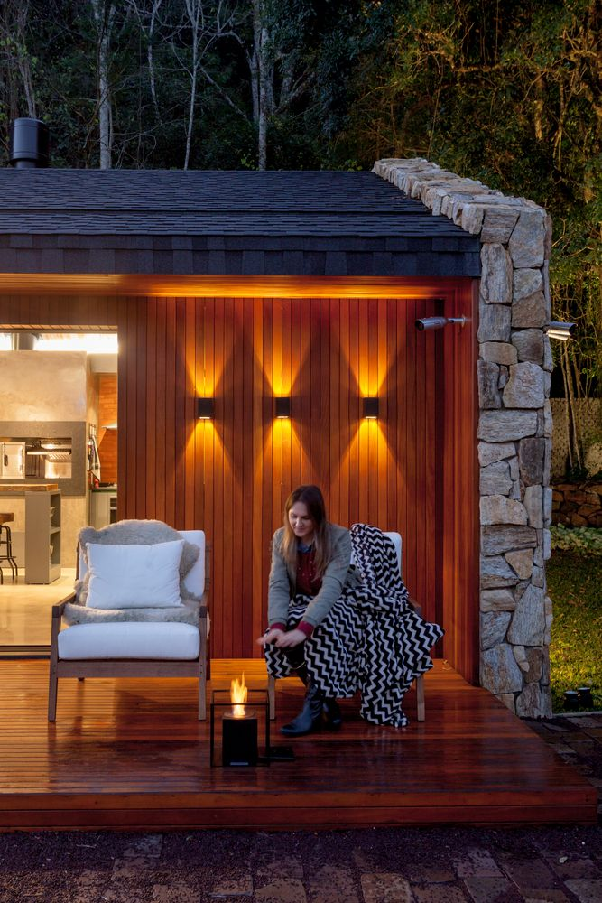 The chairs on the deck are comfortable and afford views of the landscape lighting that accents the trees.