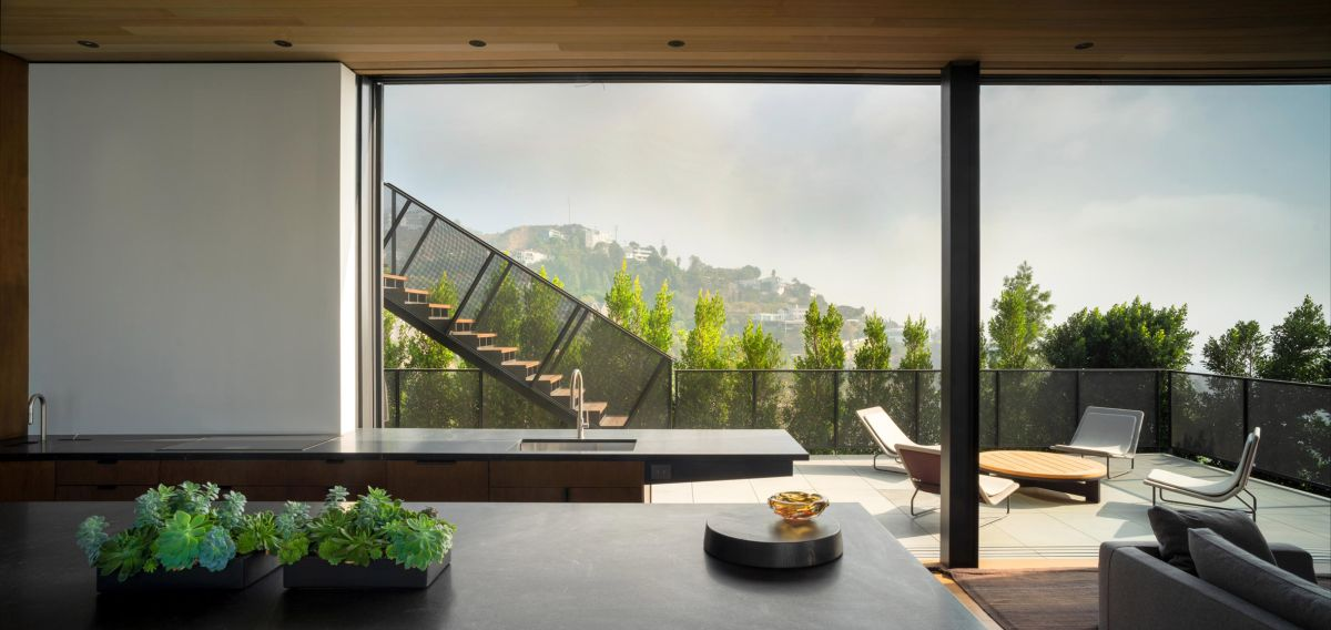 Huge windows frame the gorgeous views and invite them to become a part of the interior decor