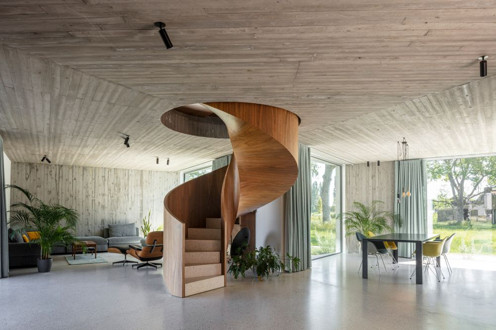 A wooden spiral staircase is positioned at the center of the floor plan and doubles as a decoration
