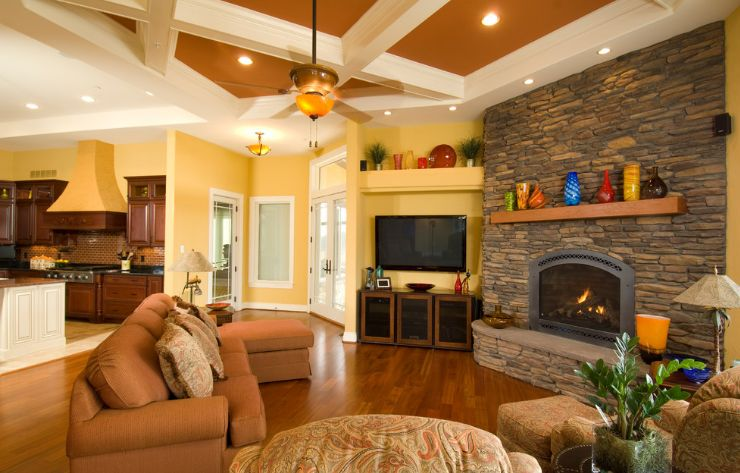 rustic fireplace mantel decorated with colorful vases