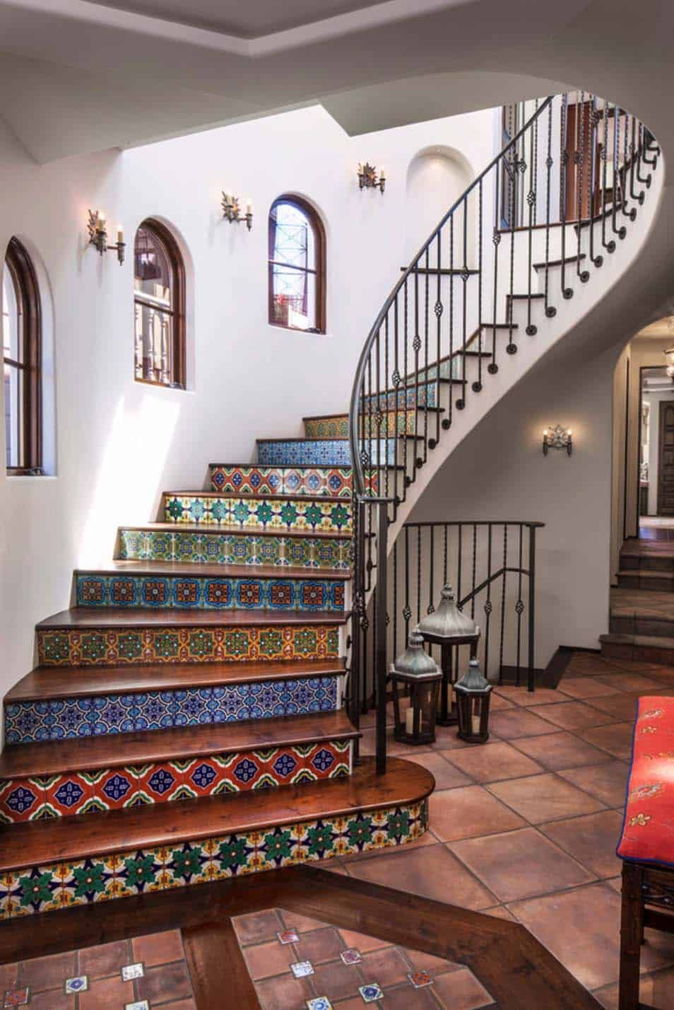 The staircase is a major focal point for the entire house thanks to its colorful tile design