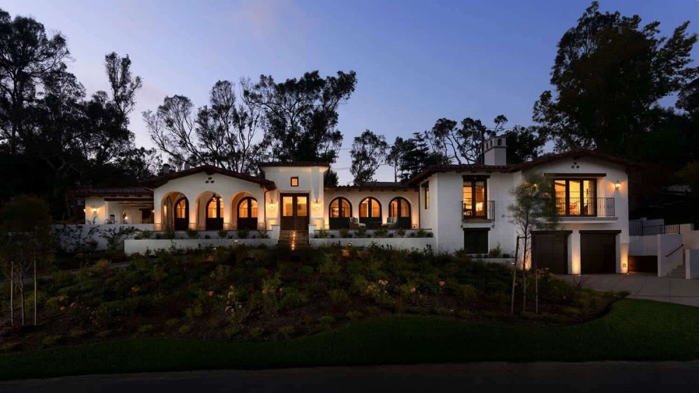 The house looks beautiful and charming inside and out, with arched windows that frame the views