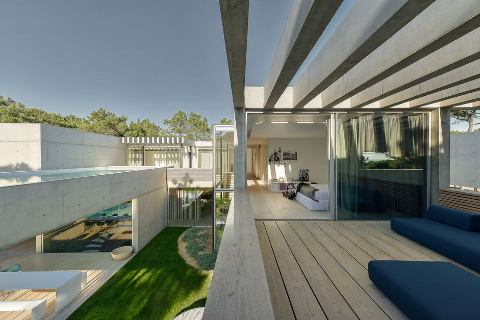 A natural wood pergola covers the deck, offering a bit of shade and plenty of sky view.